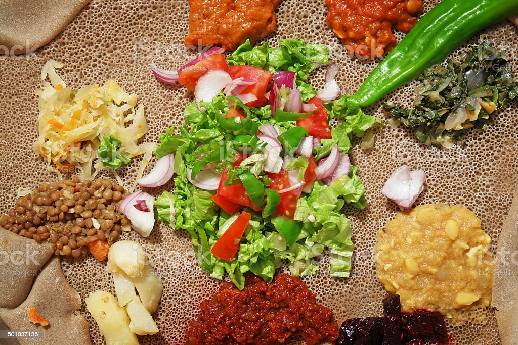 Detail of traditional Ethiopian injera meal stock photo