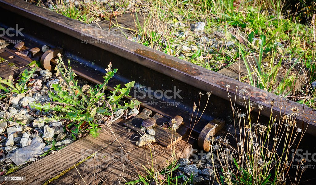 Detail of train rails old abandoned railroad. stock photo