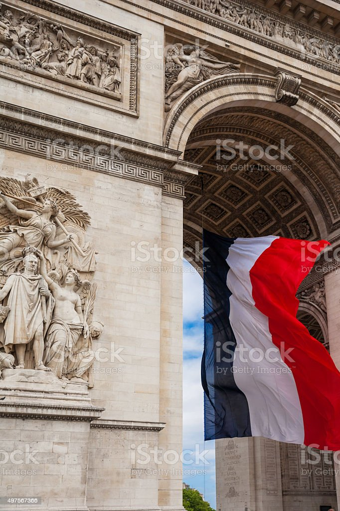 Detail of Triumphal Arch with national flag of France, Paris, France stock photo