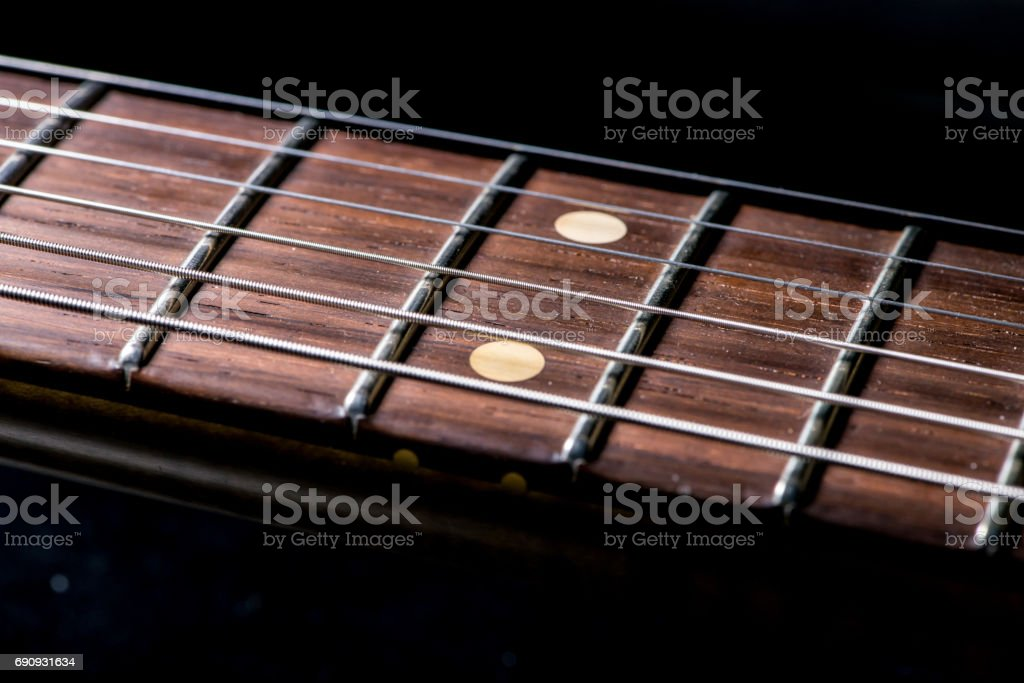 detail of vintage electric guitar fingerboard stock photo