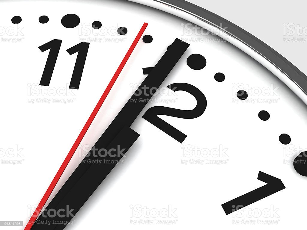 Detail of wall clock marking 12 o'clock stock photo