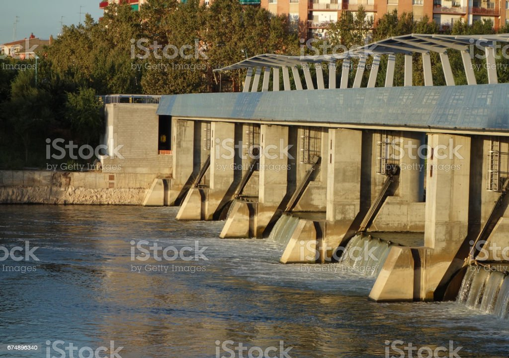 detail of weir at the lower side from the upper part and the opposite shore on the Ebro river, Saragossa stock photo