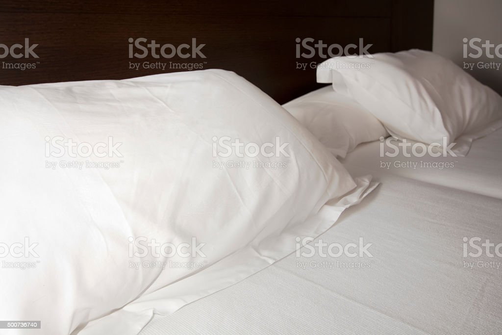 Detail of white pillows in a bedroom. stock photo