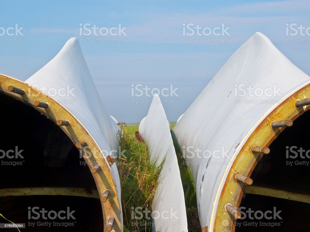 detail of wind turbine blades awaiting assembly stock photo