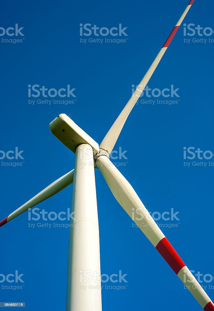 detail of wind turbine in blue sky stock photo