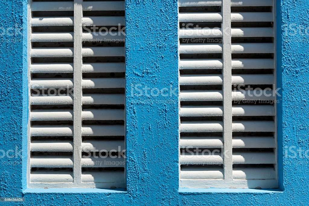 Detail of window with white sun blinds stock photo
