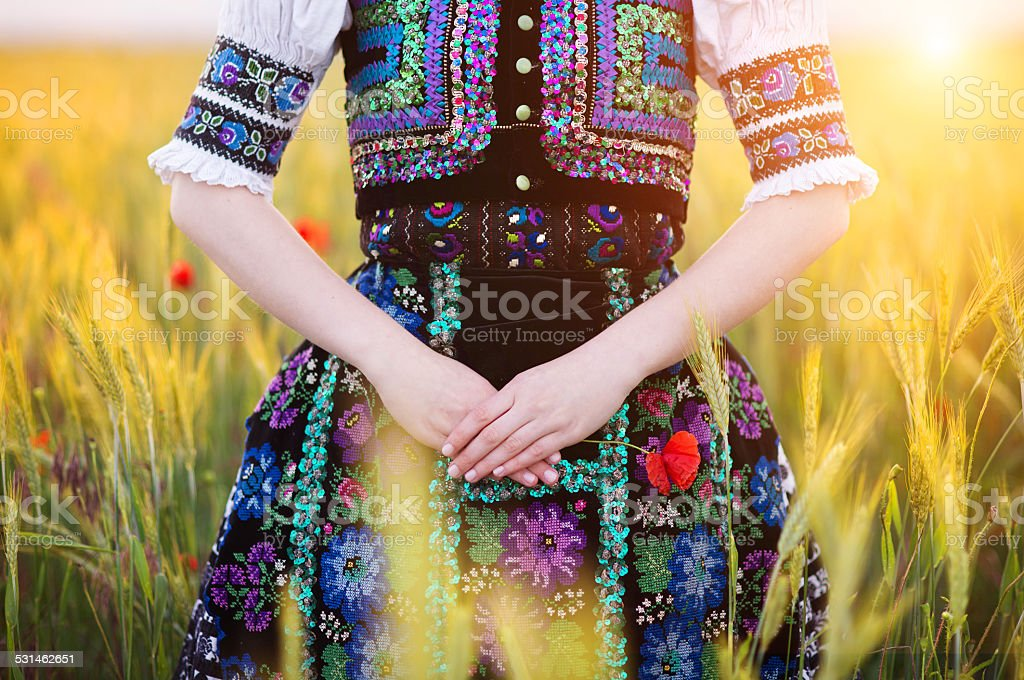 Detail of woman dress in sunlight stock photo