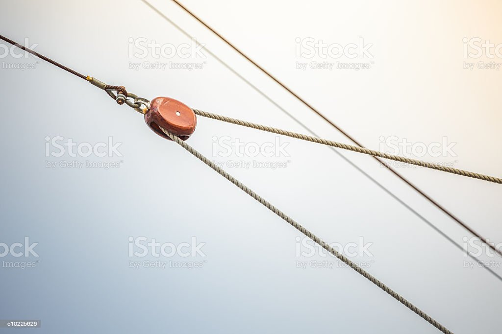 Detail of wooden rigging pulley and ropes on sail ship stock photo