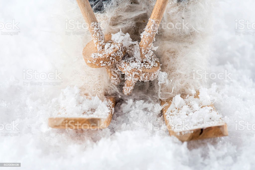 Detail of wooden ski toy on artificial snow stock photo