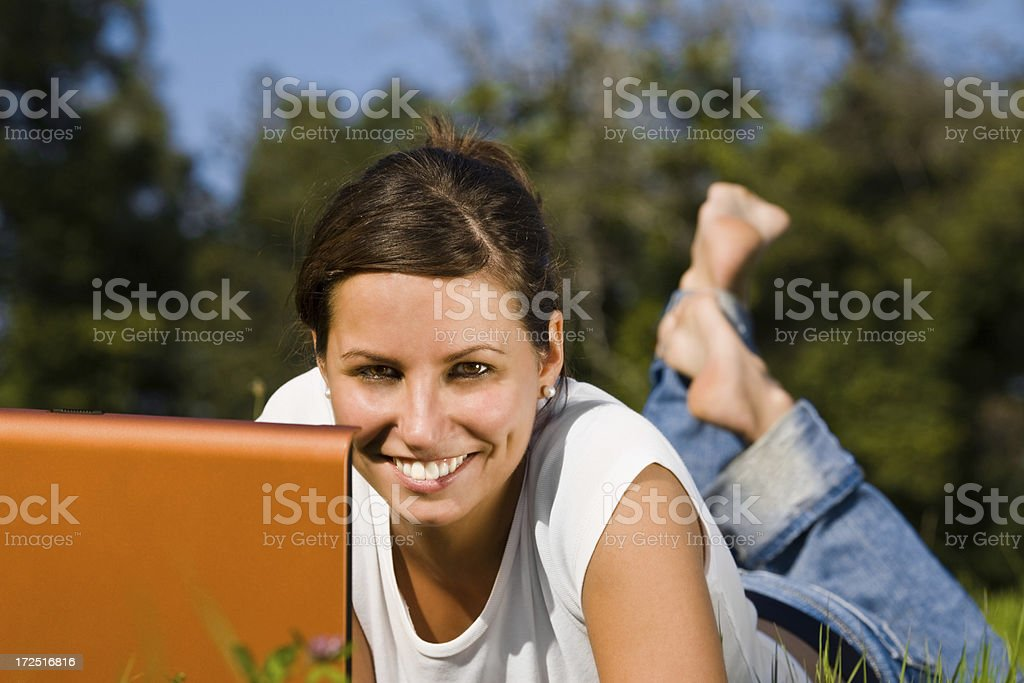 detail of young beautiful girl working with laptop outdoor royalty-free stock photo