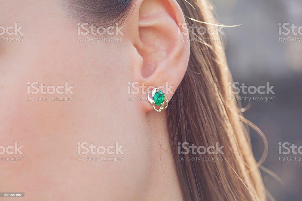 Detail of young woman wearing beautiful luxury earring stock photo