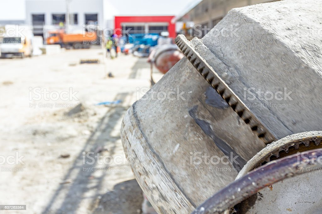 Detail on mechanism at cement mixer machine gear, close-up stock photo