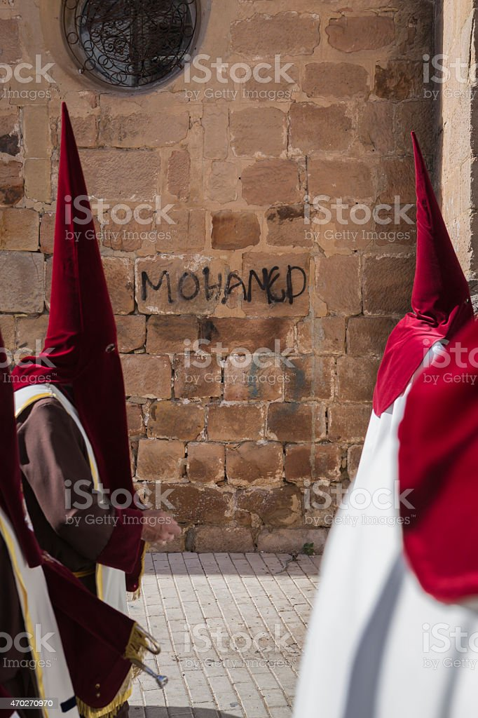Detail penitent red holding a candle during Holy Week stock photo