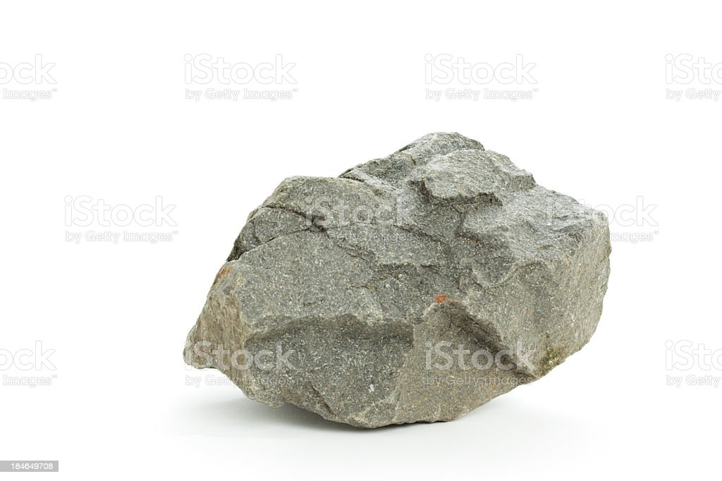 Detail photograph of a basalt rock on a white background stock photo