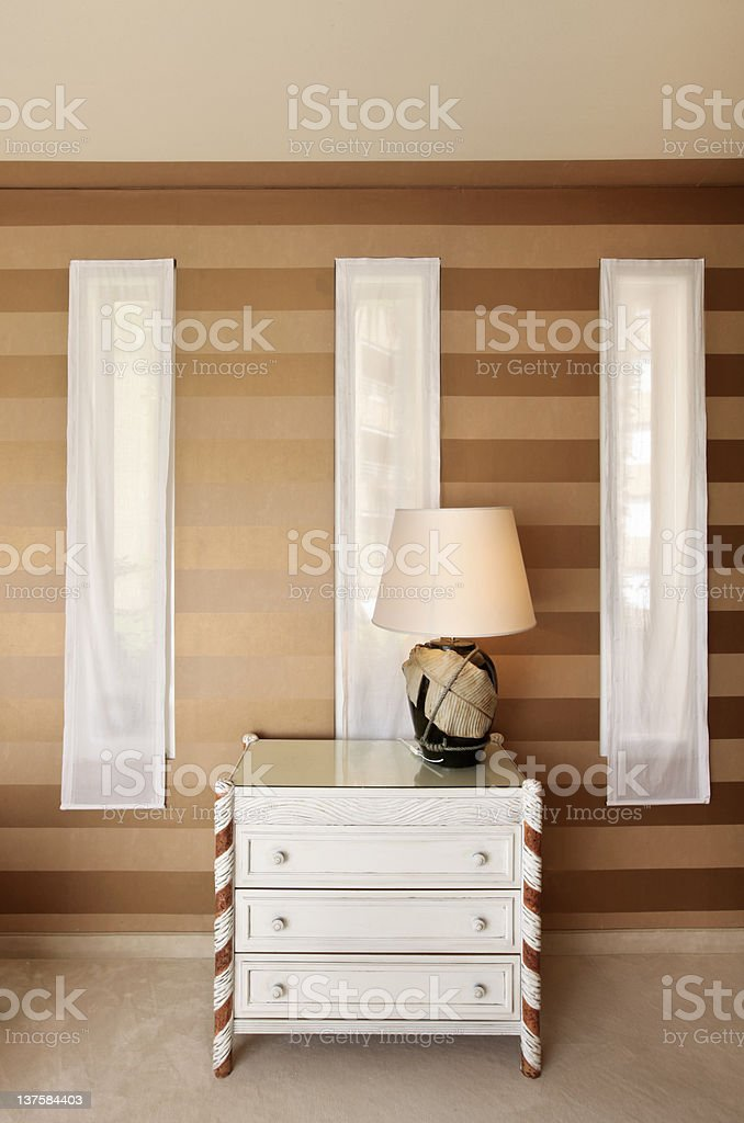 detail room, table lamp and dresser royalty-free stock photo