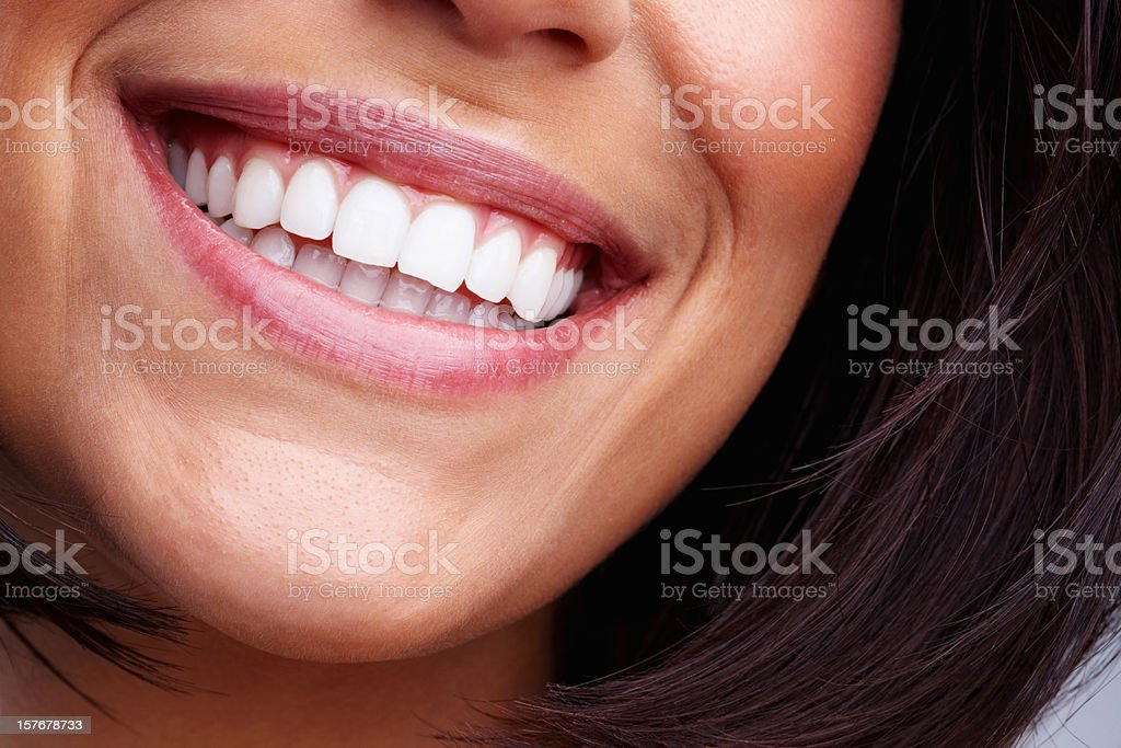 Detail shot of a pretty young female smiling stock photo