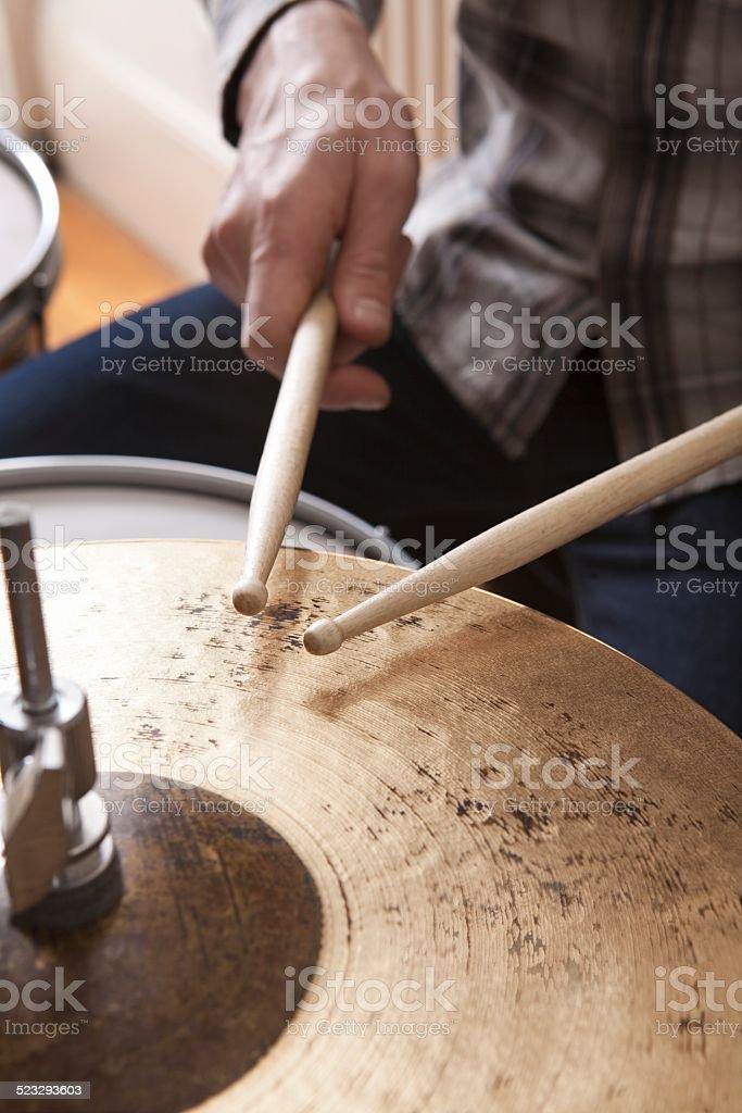 Detail shot of drumsticks on metal cymbal stock photo