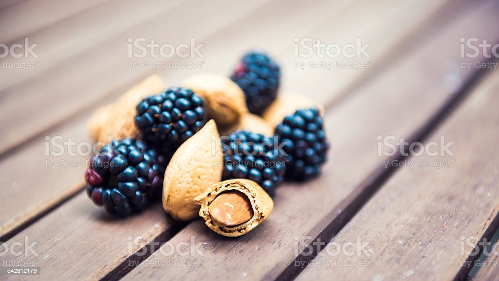 Detail shot of some delicious almonds and blackberries stock photo
