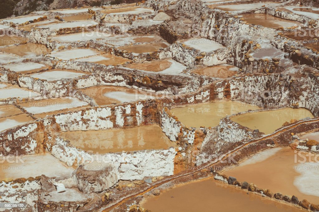 Detail view of the Maras salt ponds located in Peru's Sacred Valley. stock photo