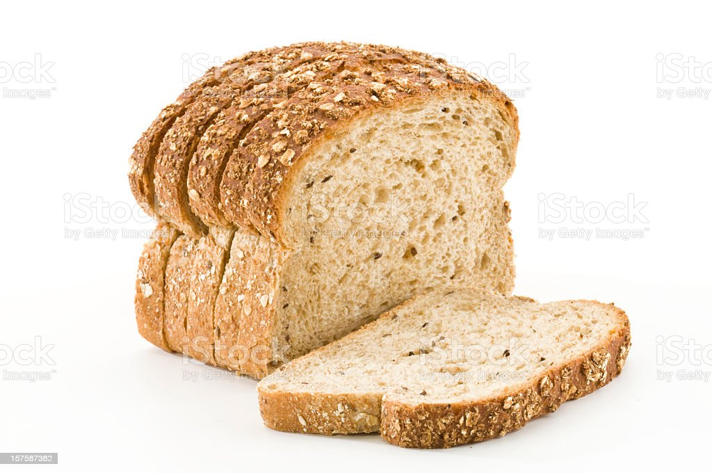 Detailed close-up of sliced grain bread on white background stock photo