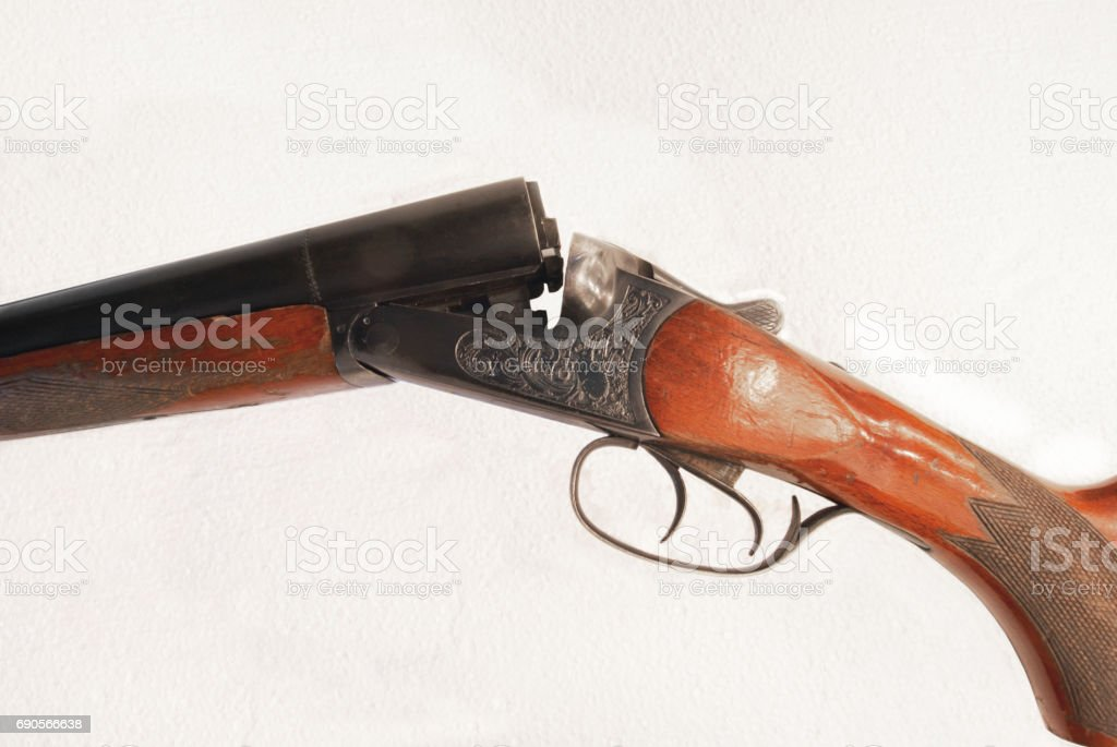Detailed photo of a double-barrel rifle on a white background stock photo
