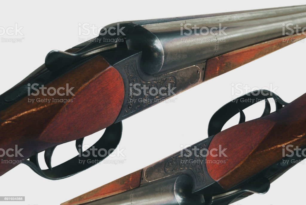 Detailed picture of a double-barreled gun on an isolated backgro stock photo