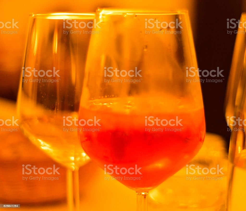 Detailed shot of glass of red wine on table, Italy stock photo
