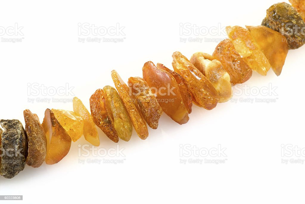 Detailed shot of unprocessed amber necklace royalty-free stock photo