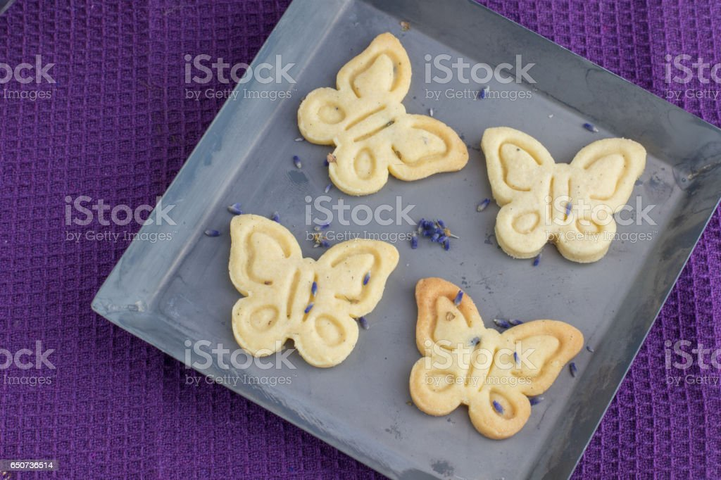 Detailed Top View Four biscuits cookies with lavender on an Sheet tray stock photo