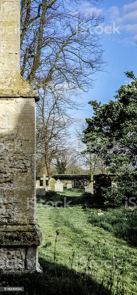 Detailed view from a Church wall to its nearby cemetery stock photo