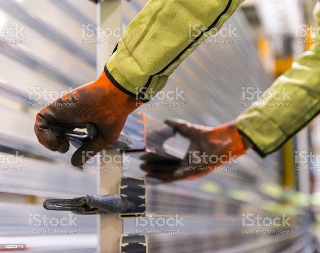 Detailed view of a worker controlling Aluminium PVC window profi stock photo