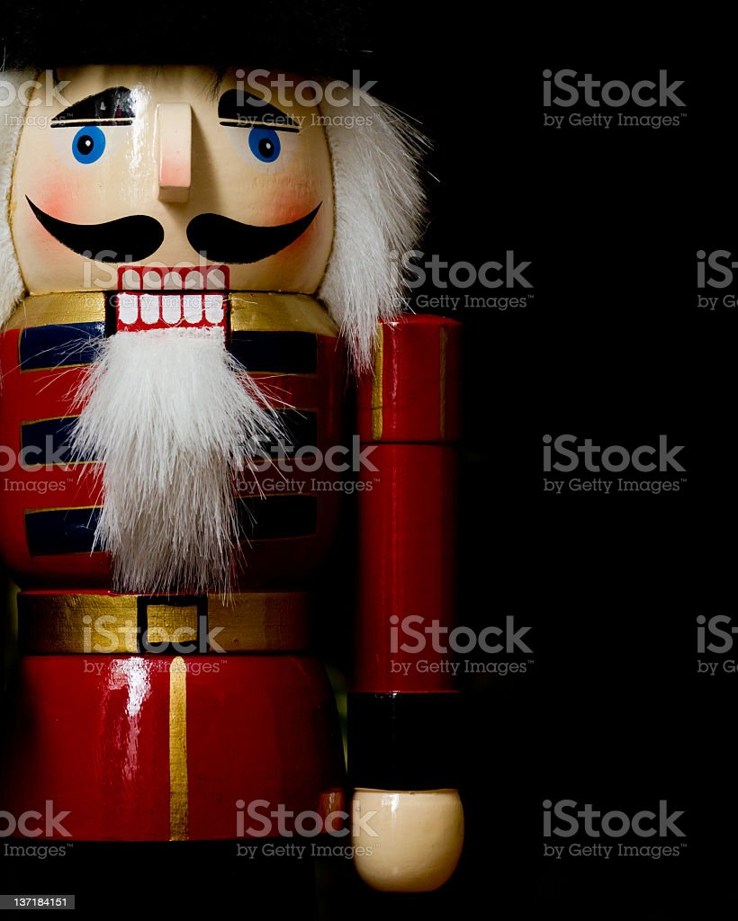 Detailed view of nutcracker, on black background  stock photo