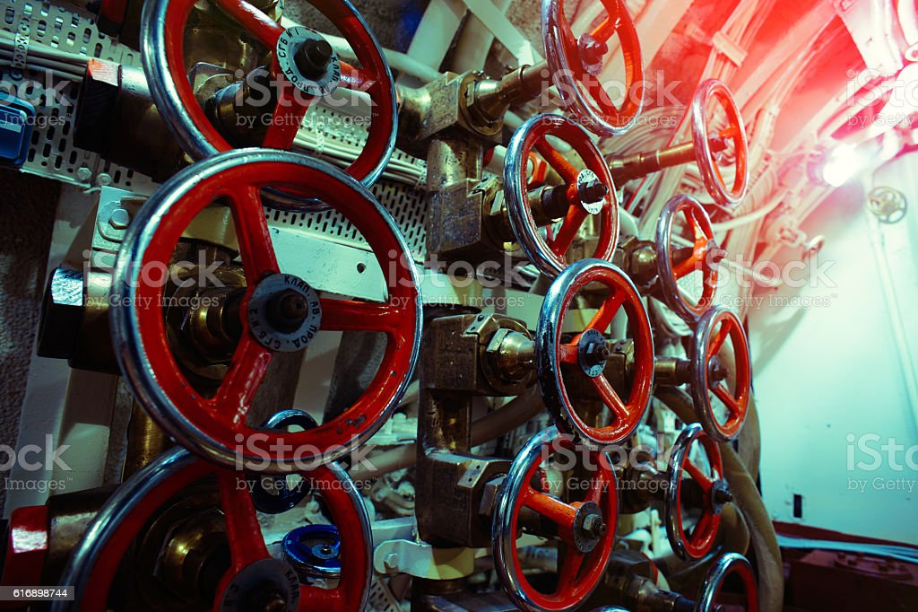 Detailed view of valves and pipes in old submarine stock photo
