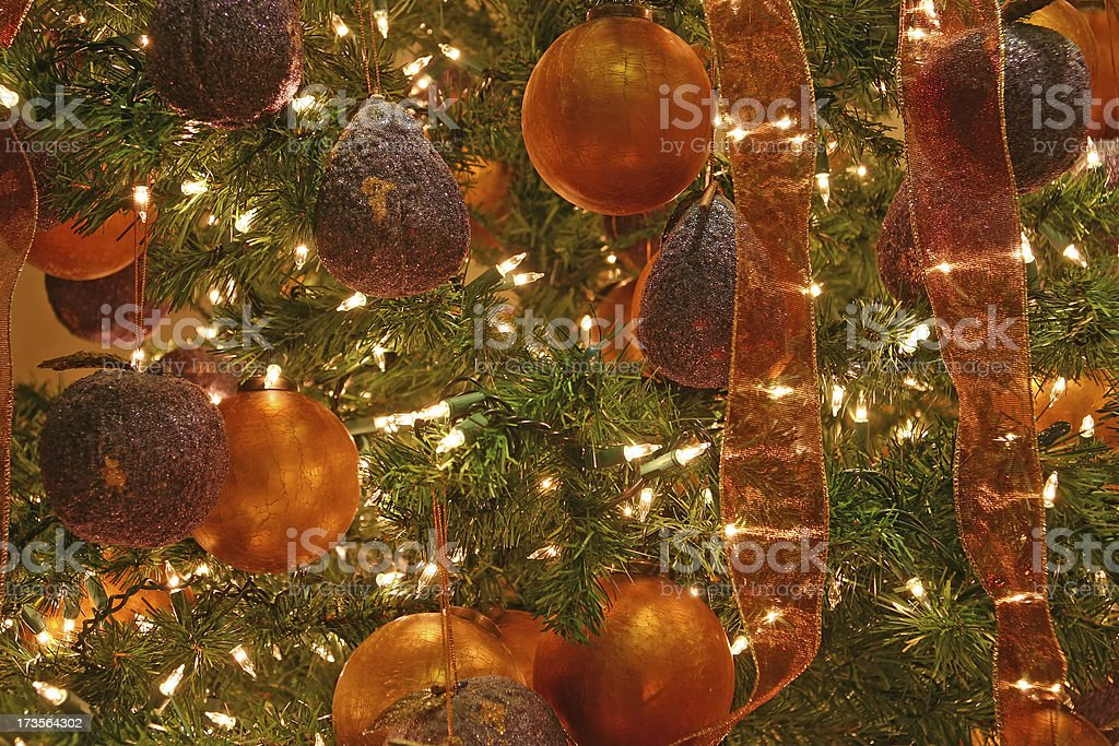 Details of a christmas tree with golden decoration royalty-free stock photo
