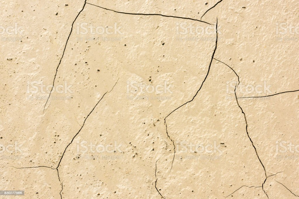 details of a dried cracked seabed stock photo