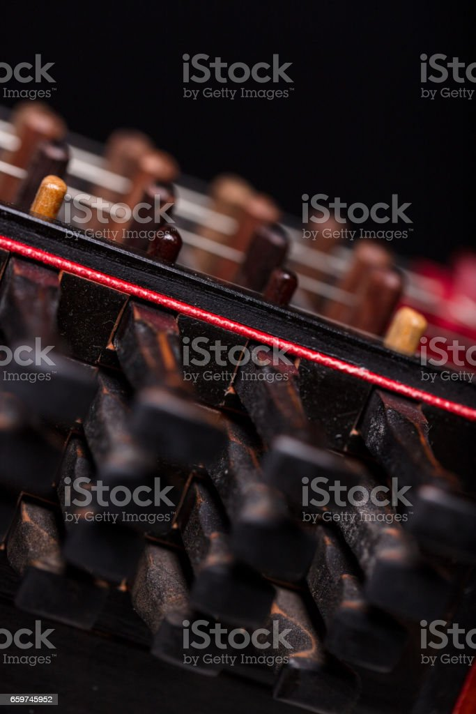 details of ancient musical instrment on black background stock photo