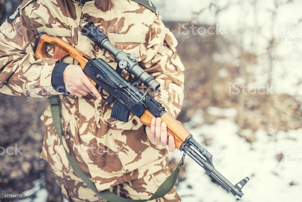 details of equipment and gun on military ranger stock photo