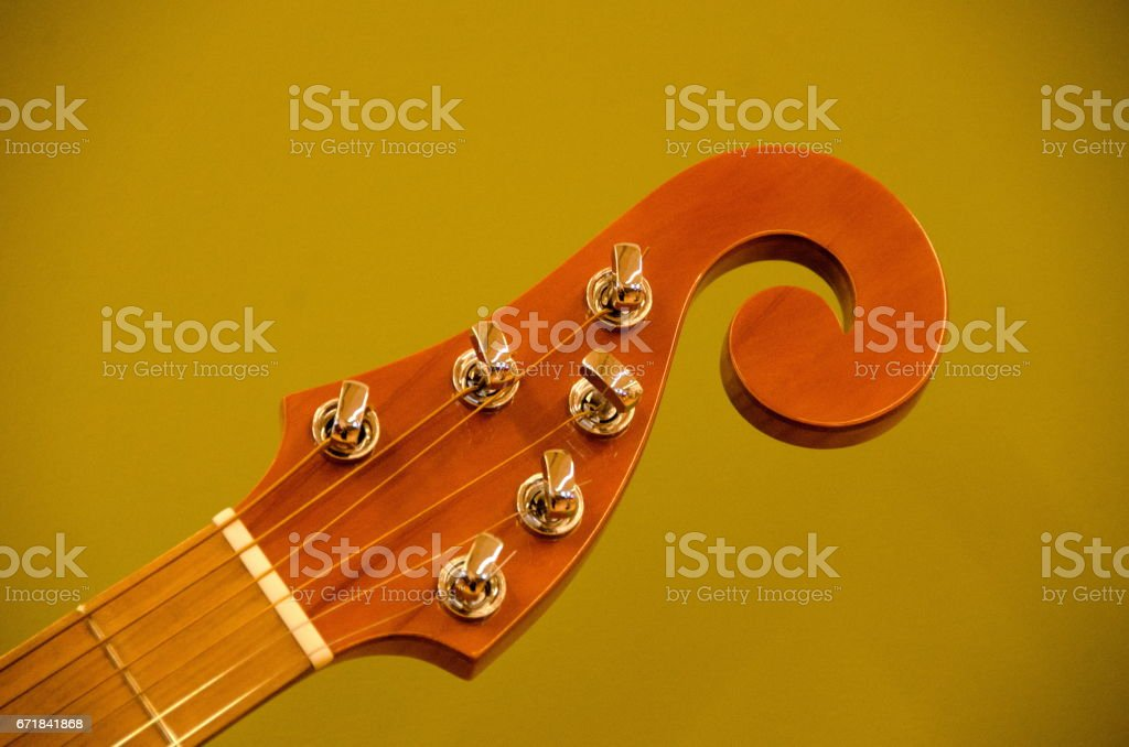 Details of headstock of s tring musicla instrument with olive background stock photo
