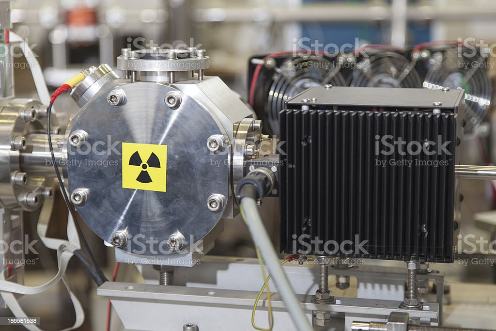 Details of ION accelerator with radiation warning sign stock photo