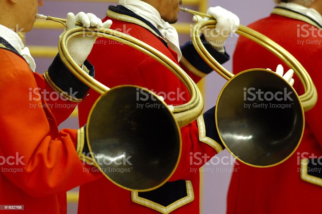 details of musicians playing on hunting horns stock photo