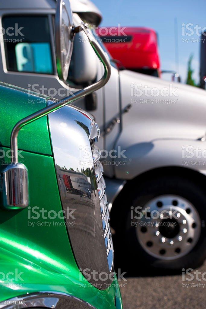 Details of semi-trucks on truck stop parking lot stock photo