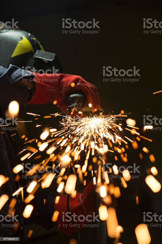 Details of Sparks from a Grinder with Worker stock photo