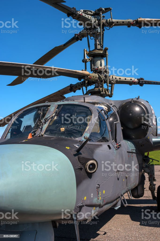 Details of the rotor and part of the body of modern military helicopters closeup. stock photo