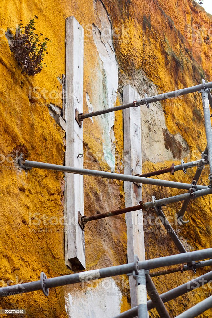 Details of the supports of old facade works stock photo