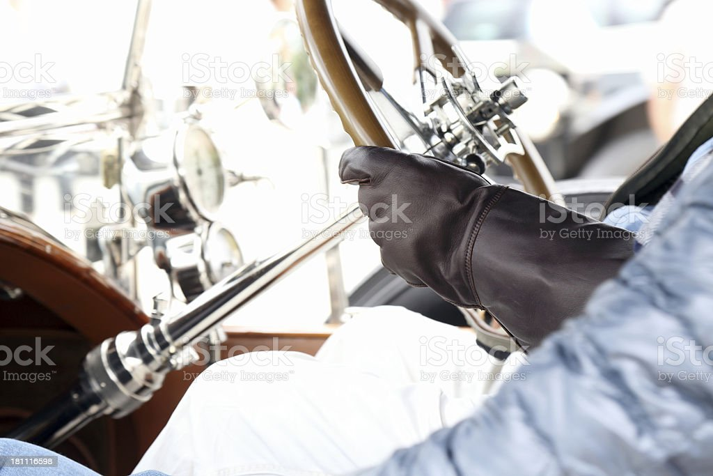 Details of vintage classic Rolls Royce and driver stock photo