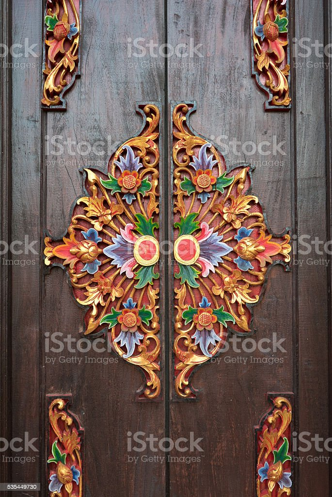 Details of wooden ornate entrance door to temple In Bali stock photo
