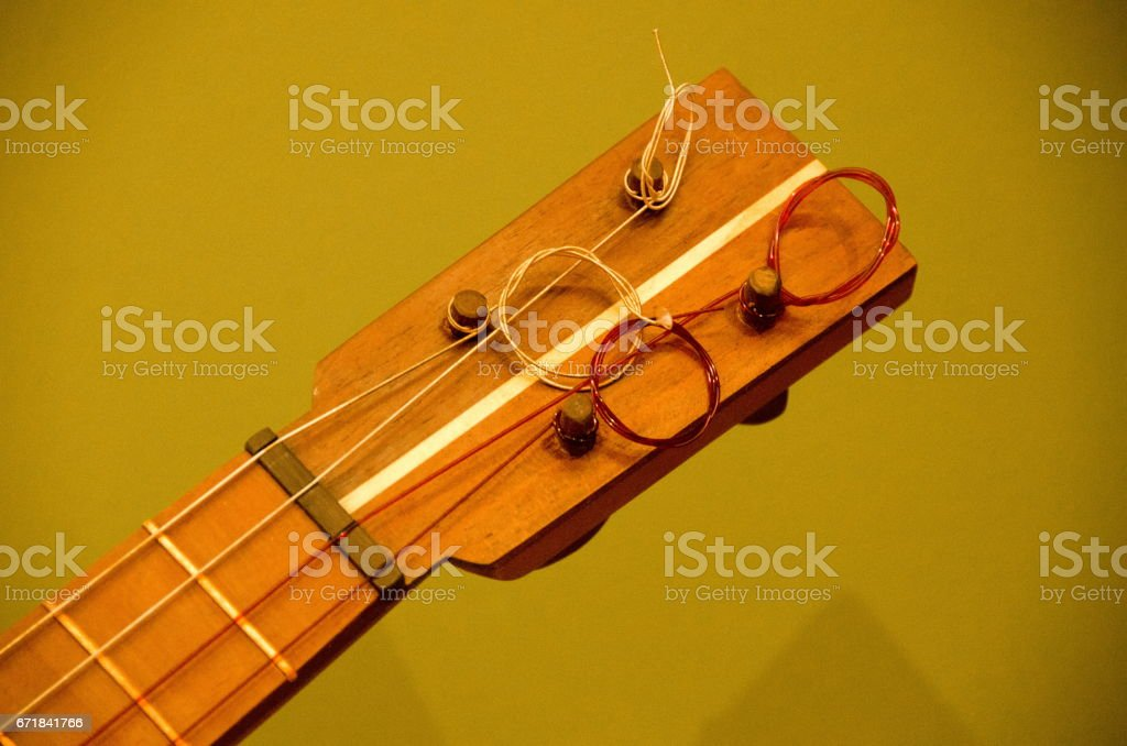 Detaisl of ukelele  headstock with olive background stock photo