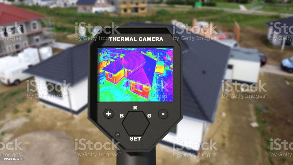 Detecting Heat Loss at the House With Infrared Thermal Camera stock photo