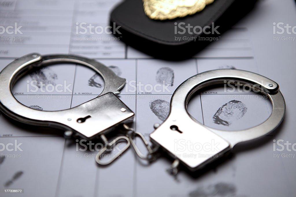 Detective Badge, Handcuffs And Fingerprints royalty-free stock photo