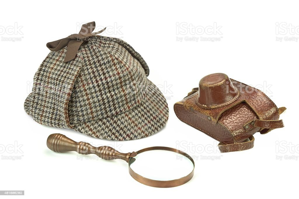 Sherlock Holmes Deerstalker Cap, Vintage Magnifying Glass And Re stock photo